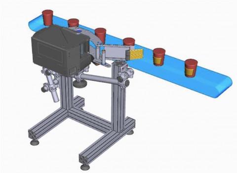 Sistema para etiquetado de latas. Capacidad hasta 4.000 latas/hora